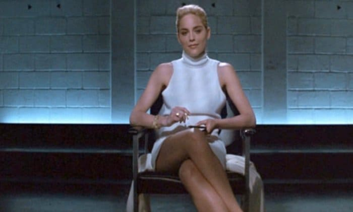 Sharon Stone in a sexy white dress while interrogated by cops