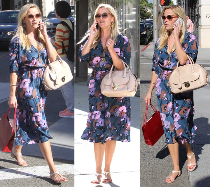 Reese Witherspoon shopping on Rodeo wearing a blue floral dress in California