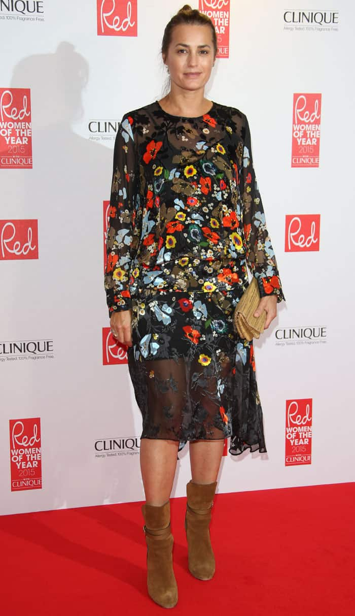 Yasmin Le Bon opted for a pair of suede boots to go with her dress and then accessorized with a brown clutch