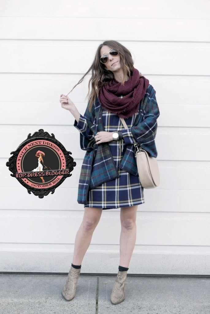 Kiara works a plaid-on-plaid look with snakeskin ankle boots