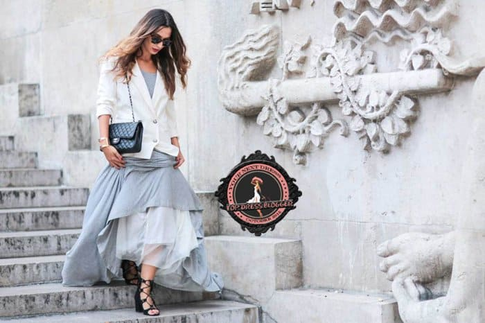 Sofya is a modern-day princess in a blue-gray maxi dress with strappy heels
