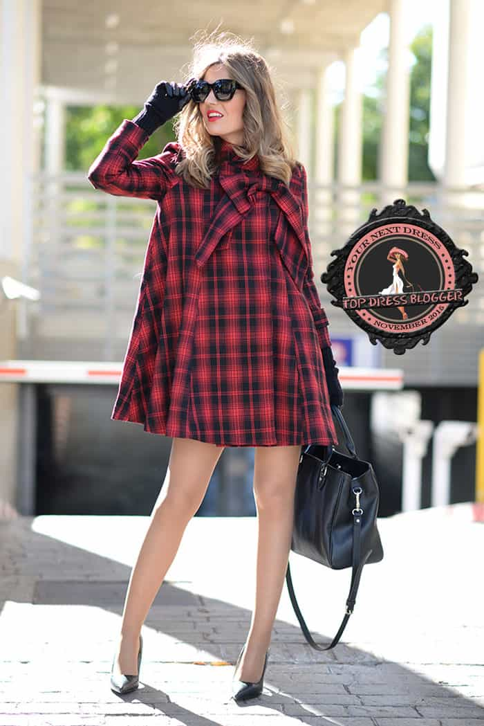 Helen's swing-style plaid dress and black pumps