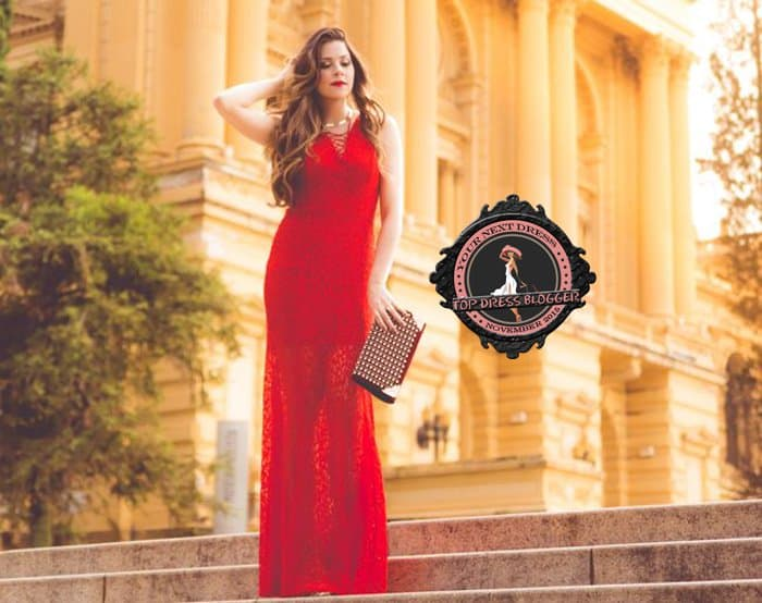 Luise highlights her slim figure in a long red lace dress