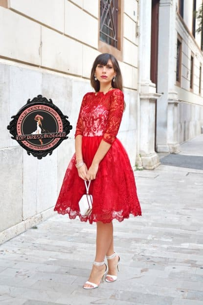 Maria Grazia is classy in a red lace dress with silver-and-white high heel sandals