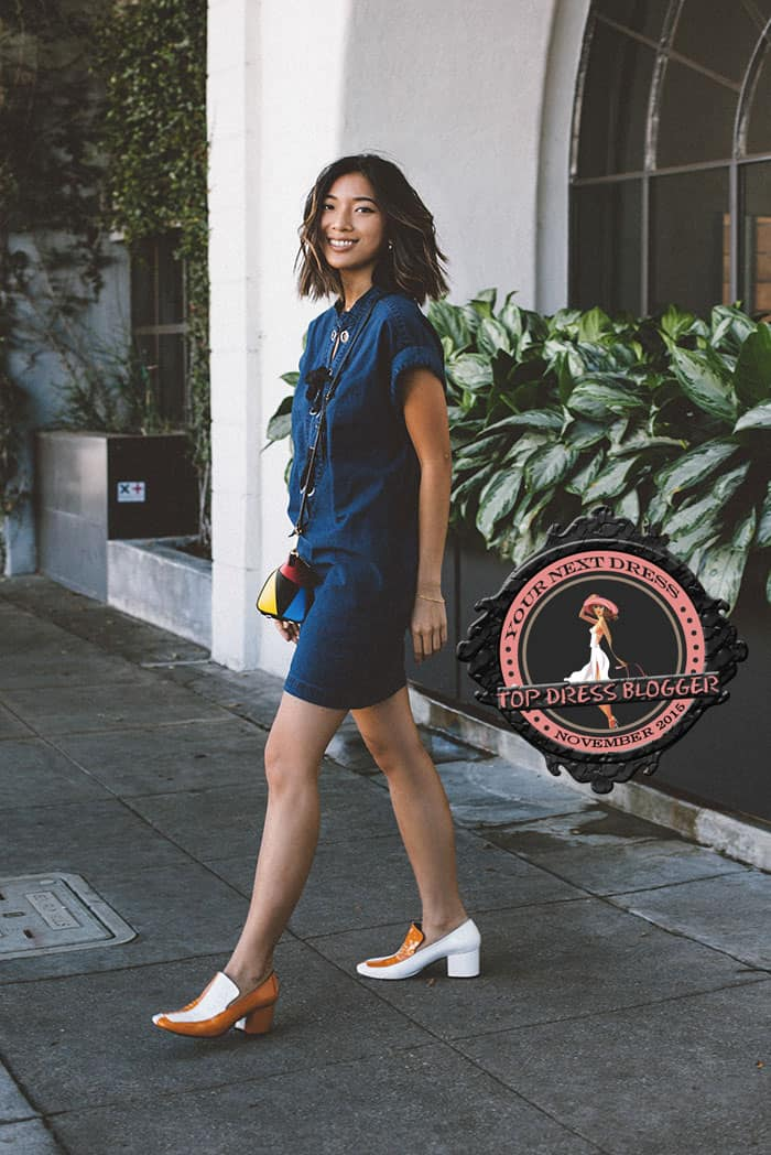 Stephanie wears her denim dress with colorblock heels and geometric bag