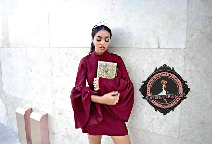 Daphne's plain burgundy mini dress with interesting bell sleeves