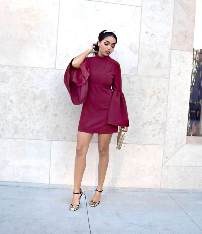 Daphne teams her long-sleeved mini dress with metallic heels