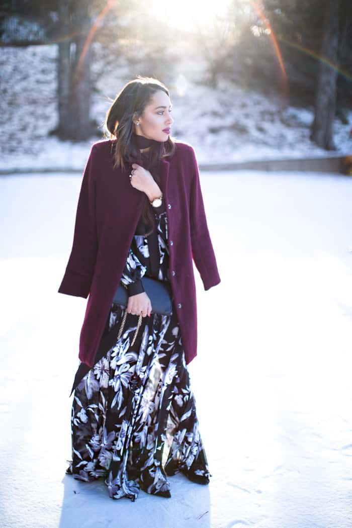 Elizabeth layers a burgundy coat over her summery maxi dress