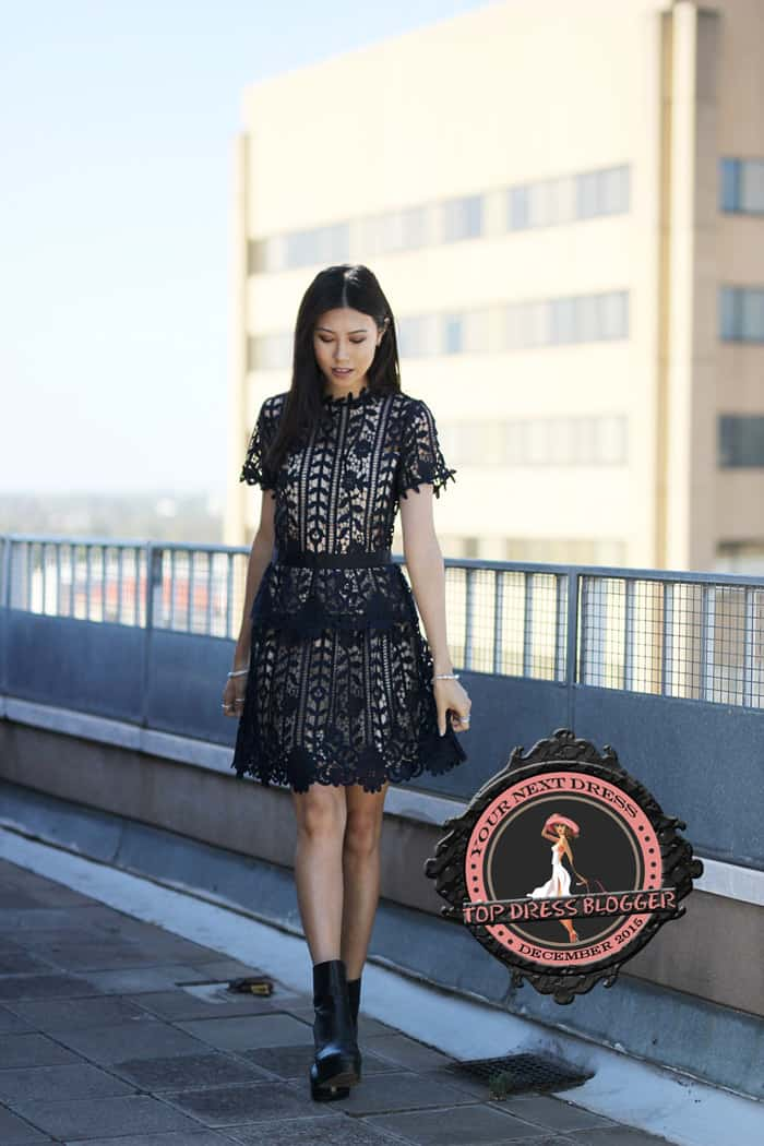 Jody teams a feminine lace dress with a pair of tough-chic black ankle boots