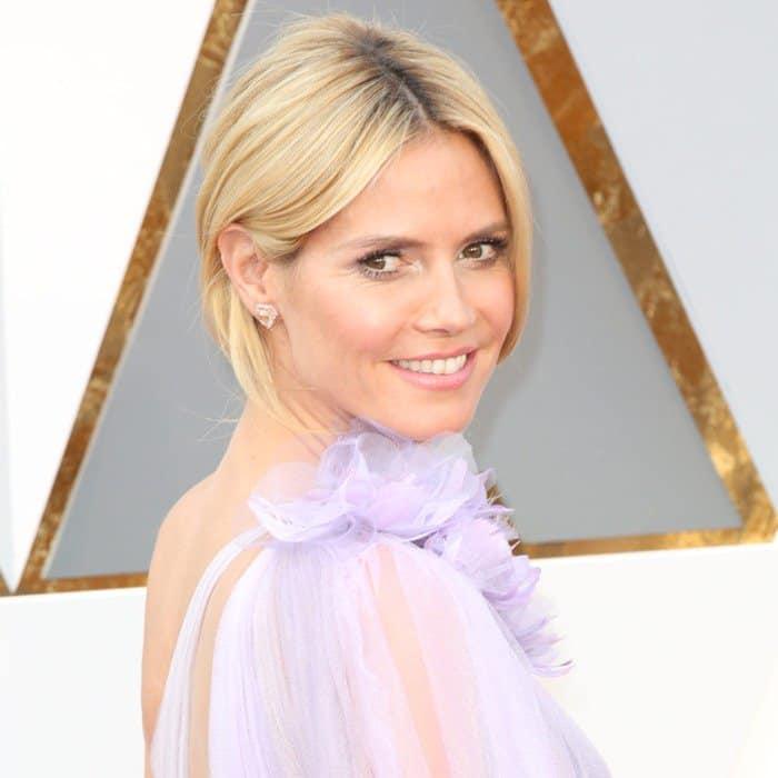 Blonde beauty Heidi Klum in a lavender Marchesa gown