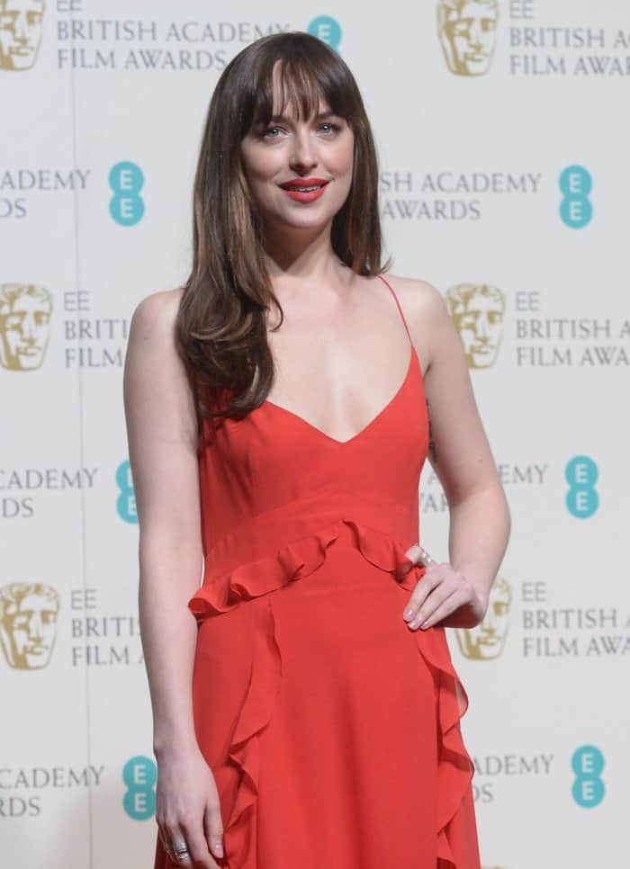 Dakota Johnson Dior red suffled gown BAFTAs 2016