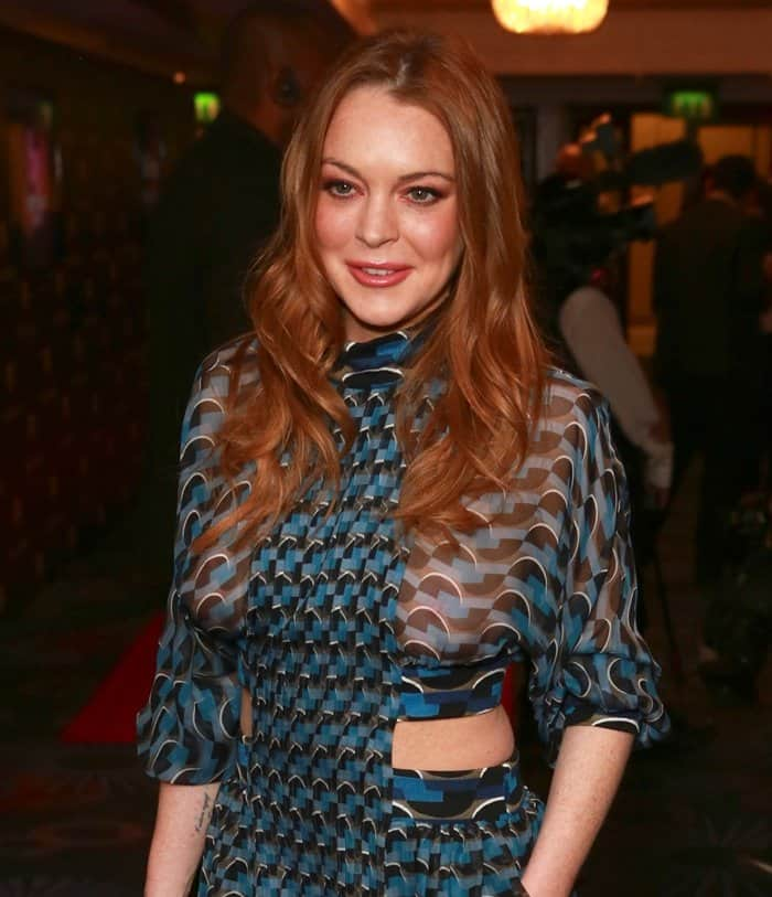 Lindsay Lohan Flashes Breasts in Revealing Sheer Dress