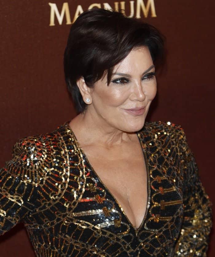 Kris Jenner wearing black and gold Balmain dress