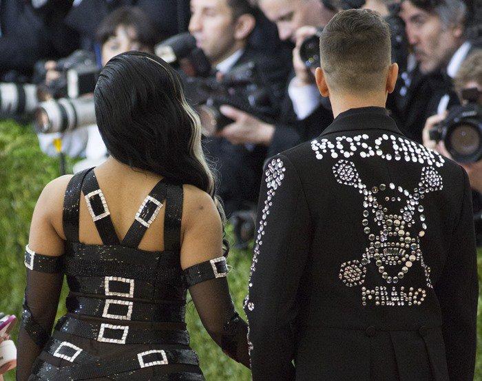 Nicki Minaj's gownfeaturing rhinestone buckles fastened around her shoulders