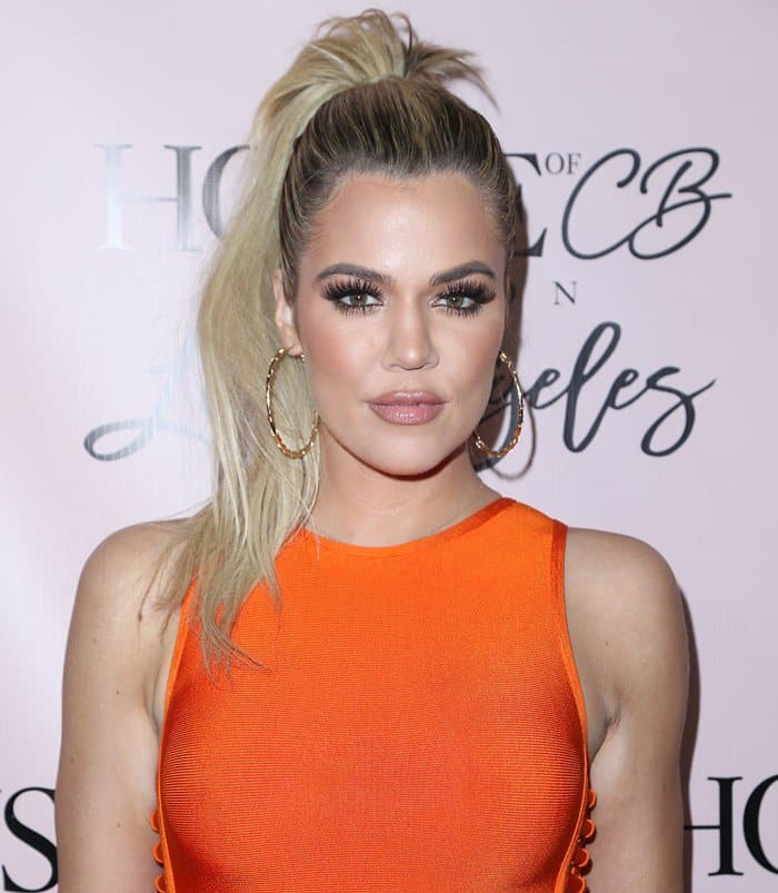 Khloe wearing a House of CB 'Martinique' burnt orange bandage dress