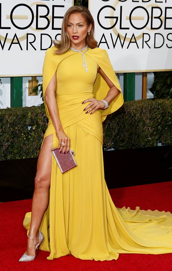 Jennifer Lopez in a yellow cape-sleeved gown from Giambattista Valli