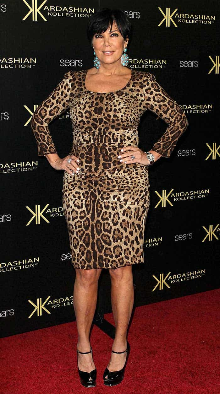 Kris Jenner styled her leopard dress with a gaudy pair of earrings and a pair of black Mary Jane platform shoes
