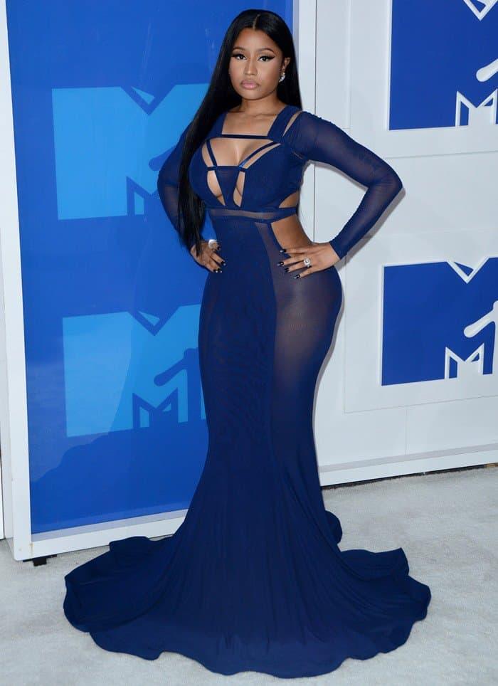 Nicki Minaj in a custom cobalt blue gown featuring a cutout design along the bodice, long sleeves, and a fishtail hem