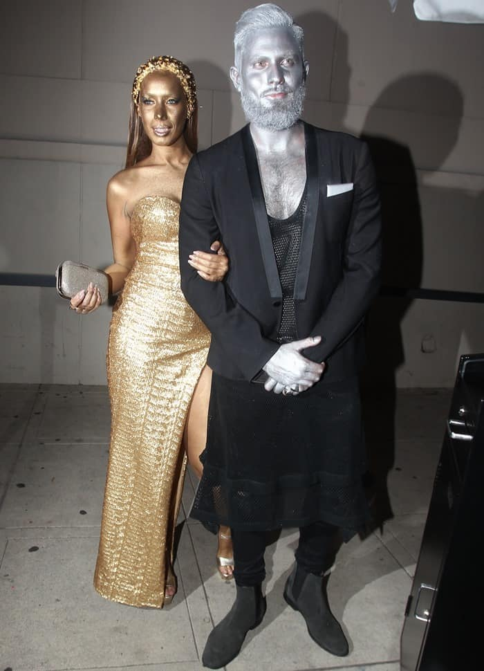 Leona Lewis and her date received metallic makeovers with their statue-like costumes
