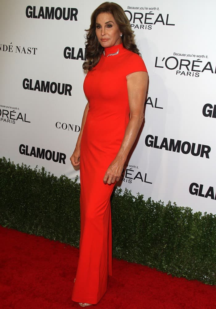 Caitlyn Jenner styled the bright orange column dress with a pair of peep-toe metallic sandals and a silver necklace
