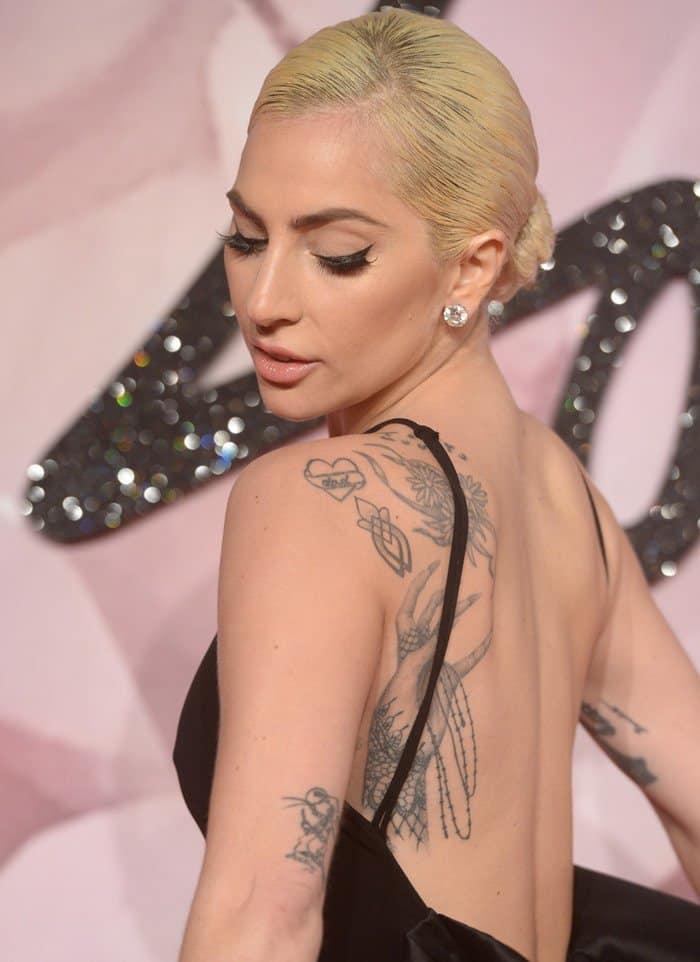 Classy Lady Gaga Impresses In Black Crepe Halter Gown