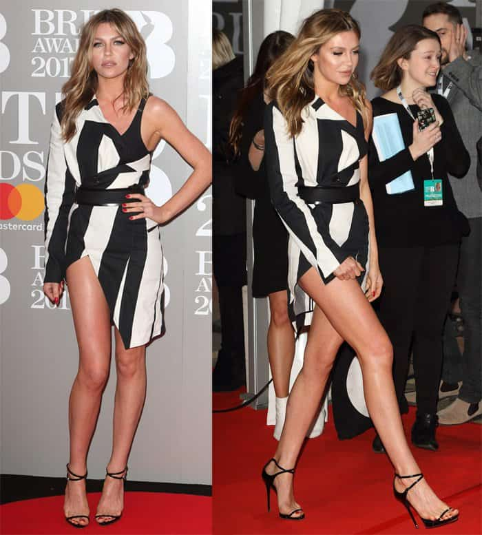 Abbey Clancy suffers a minor wardrobe malfunction at the Brit Awards 2017
