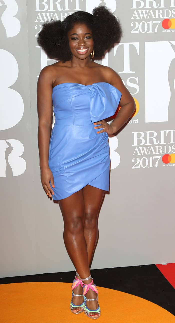 Clara Amfo wears an awful blue leather dress at the Brit Awards 2017