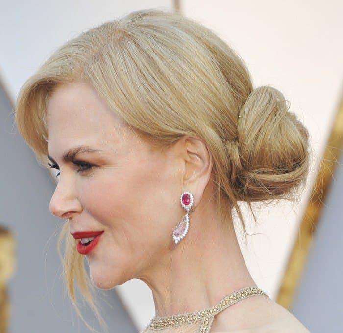 Nicole wore ruby earrings that matched her bold red lips