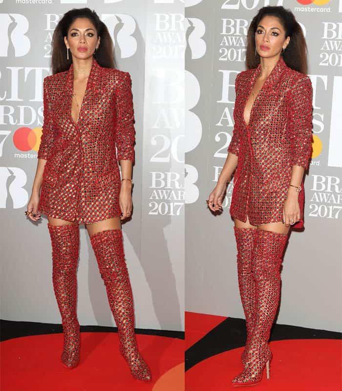 Nicole Scherzinger wears matching Nicholas Jebran blazer dress and thigh-high boots at the Brit Awards 2017