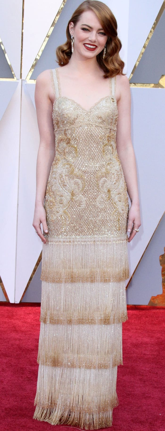 Emma Stone wearing a gold embellished gown from Givenchy at the 2017 Oscars