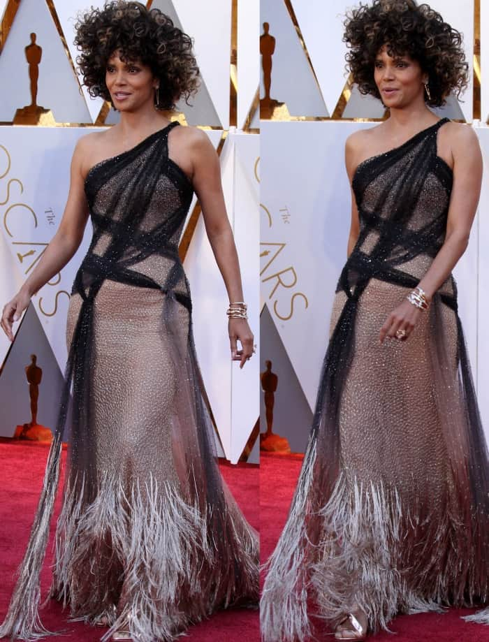 Halle Berry wearing an Atelier Versace one-shoulder gown with a metallic fringe train