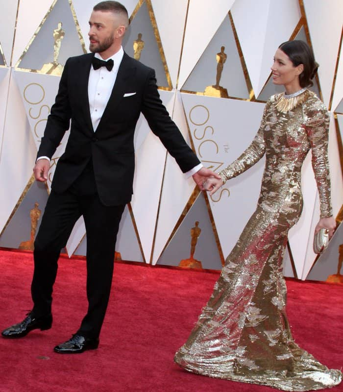 Justin Timberlake wearing a Tom Ford tuxedo and Jessica Biel wearing a gold and silver Kaufmanfranco gown at the 2017 Oscars