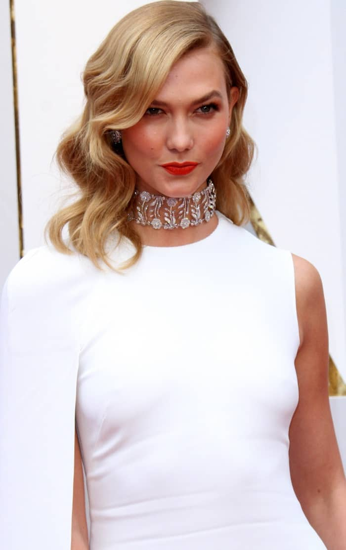 Karlie Kloss wearing a white Stella McCartney column gown with an asymmetrical cape detail at the 2017 Oscars