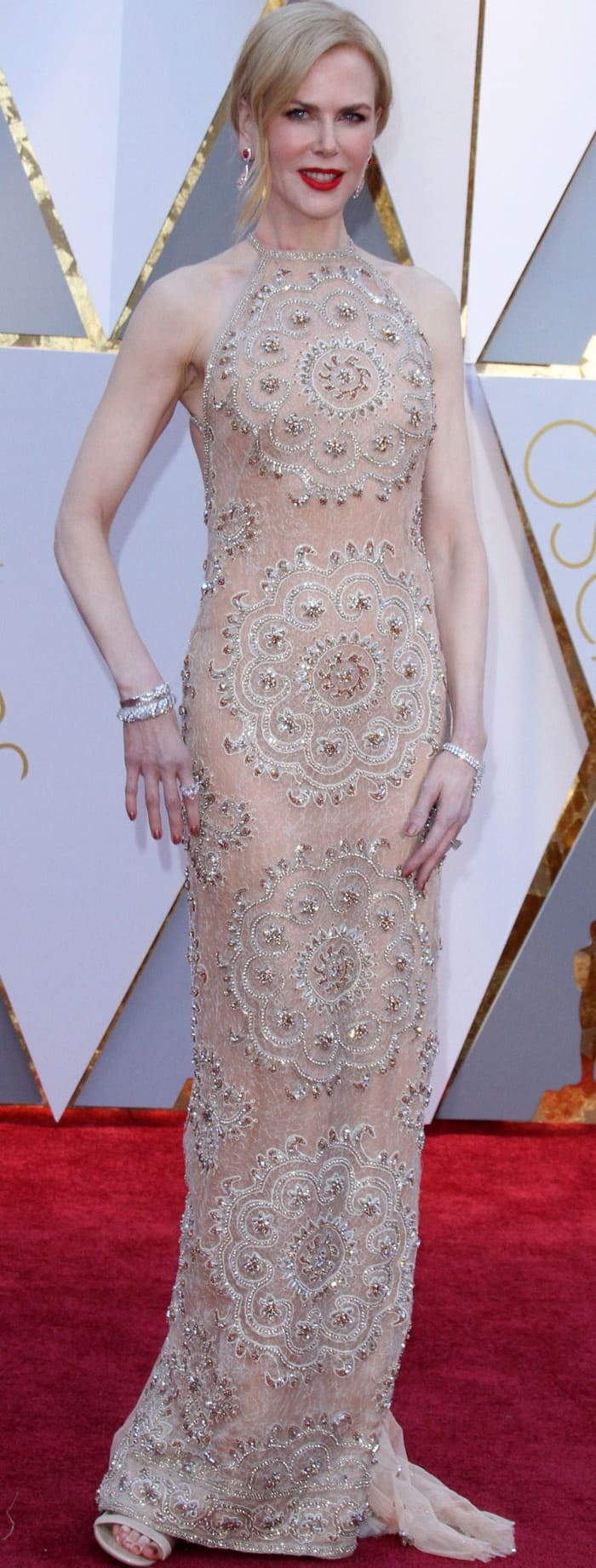 Nicole Kidman wearing a nude Armani Privé embellished column gown at the 2017 Oscars