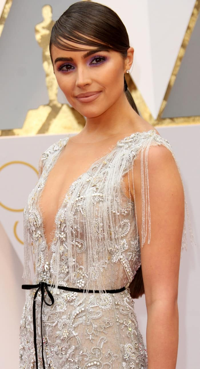 Olivia Culpo wearing a custom chalice-inspired gown from Marchesa at the 2017 Oscars