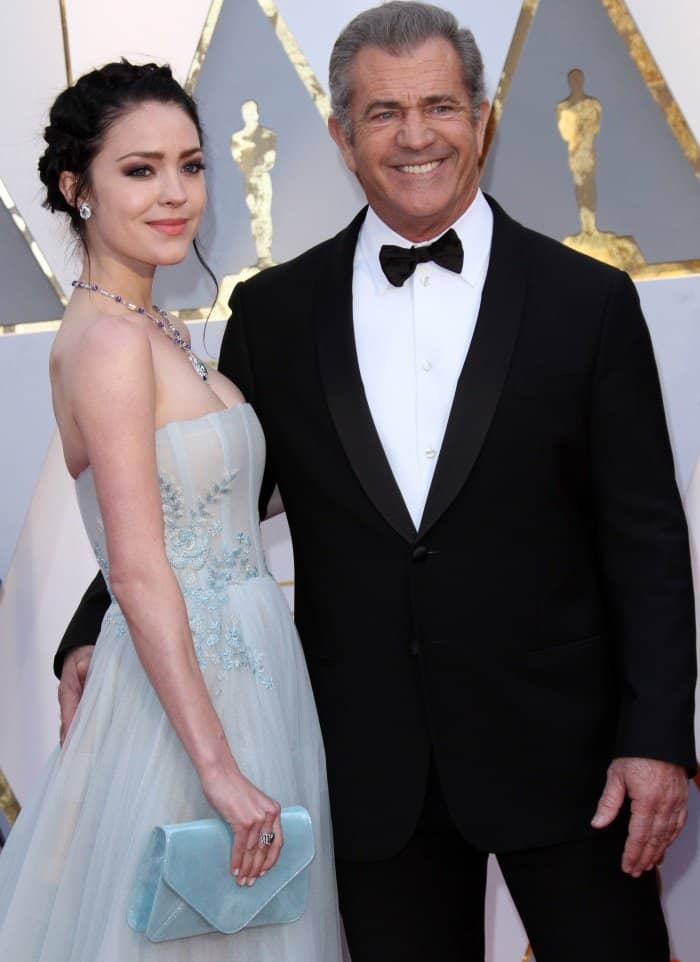 Rosalind Ross wearing a powder blue gown and Mel Gibson wearing a Giorgio Armani suit at the 2017 Oscars