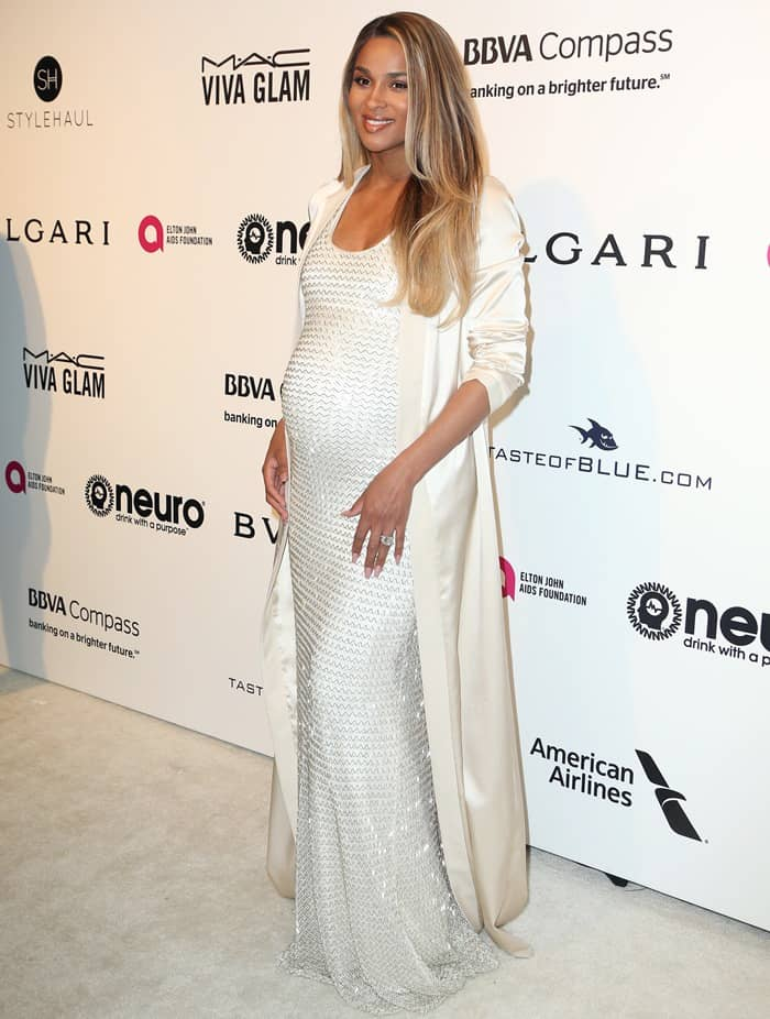 Ciara showing off her baby bump in white August Getty Atelier gown