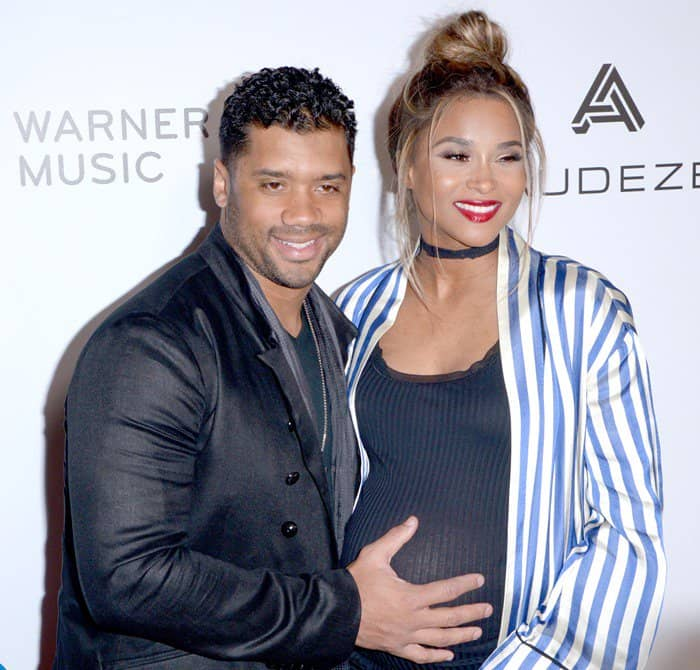 Russell Wilson, left, and Ciara attend the Warner Music Group's Celebration of the 59th Annual Grammy Awards