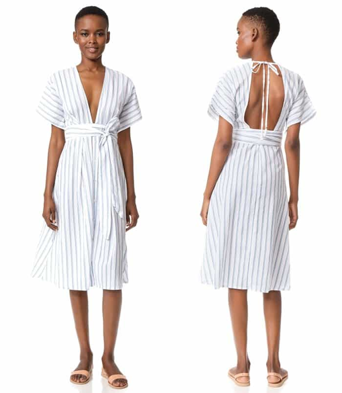 A plunging V neckline and divided back lend a daring feel to this striped shirting midi dress