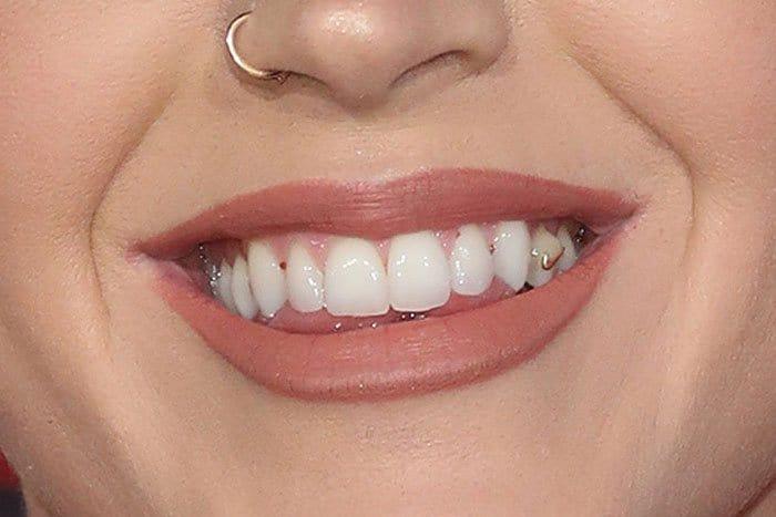 Katy Perry's gold Nike Swoosh teeth jewelry