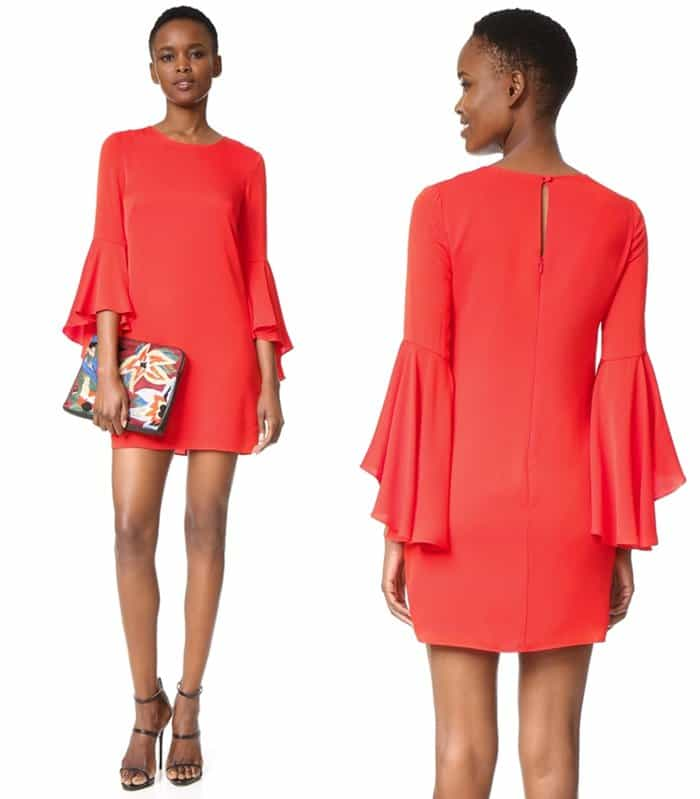 Angel sleeves give this flame-red mini dress a dramatic, retro-inspired profile