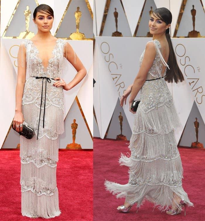 Olivia Culpo also wears a fringed dress