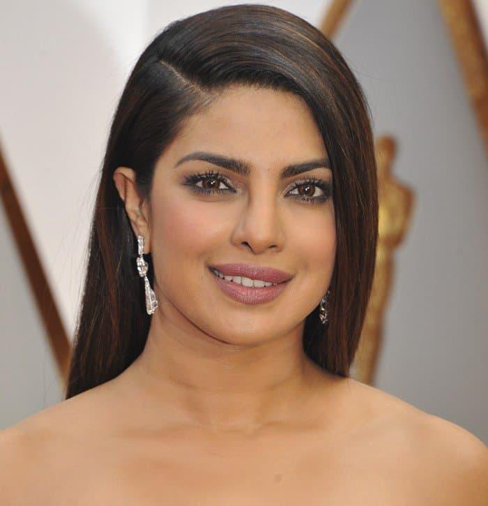 Priyanka Choprastraightened her long, dark hair, and rocked glittery eye makeup and mauve lips