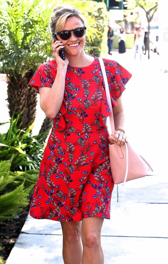 Reese Witherspoon wears a pretty floral mini dress for spa day