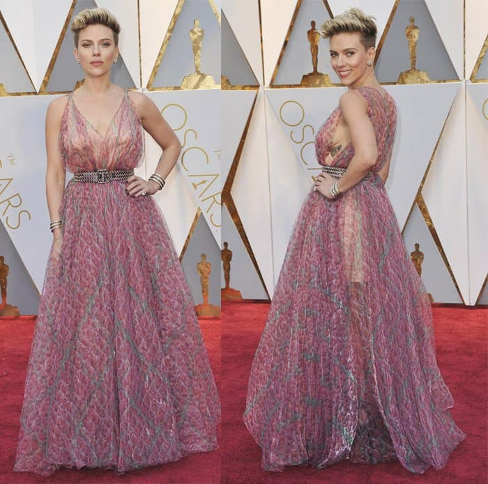 Scarlett Johansson shows off her feminine side in this pink gown.