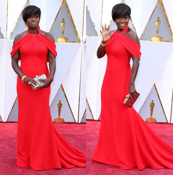 Viola Davis strikes a pose for photographers in red gown.