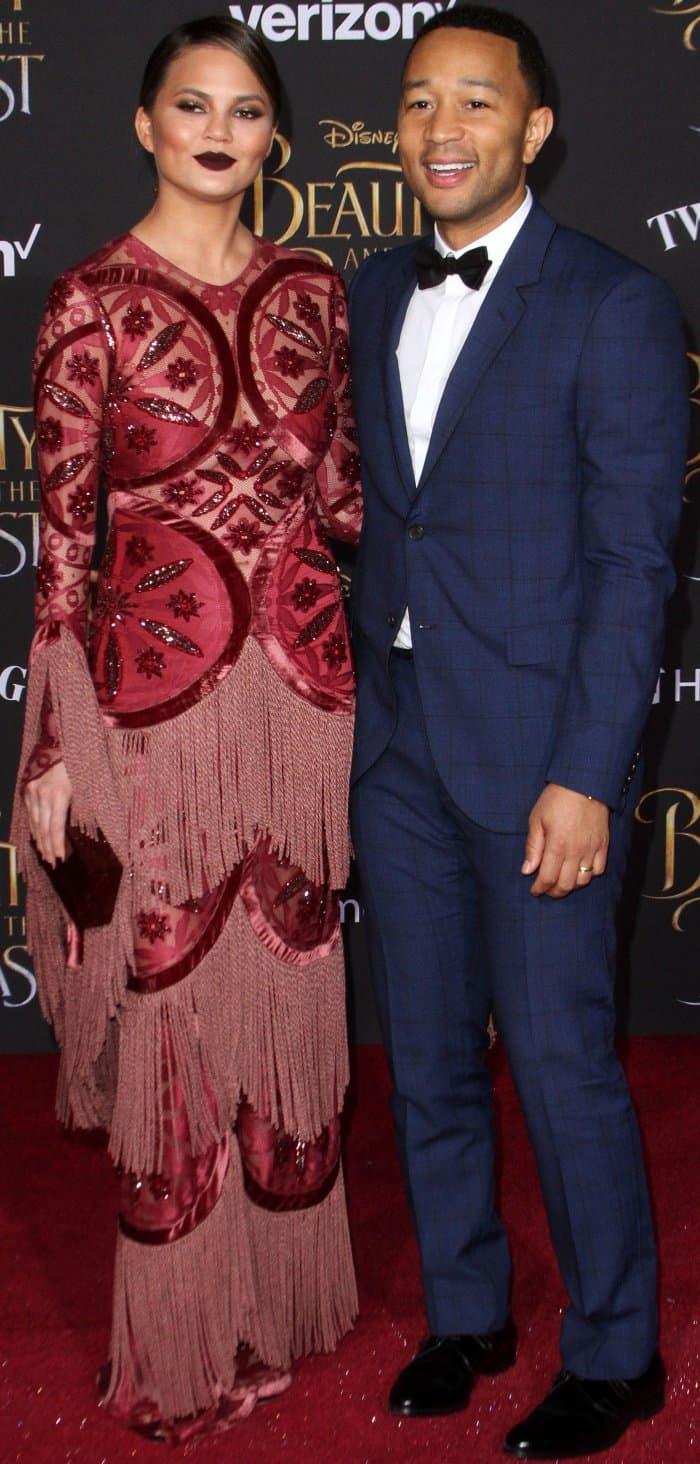 Chrissy Teigen wearing a Raisa & Vanessa gown and John Legend wearing a navy patterned tux