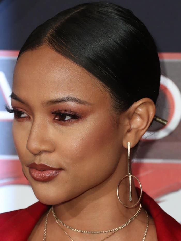 Karrueche Tran wearing a red satin Yousef Akbar two-piece suit at the 2017 iHeartRadio Music Awards