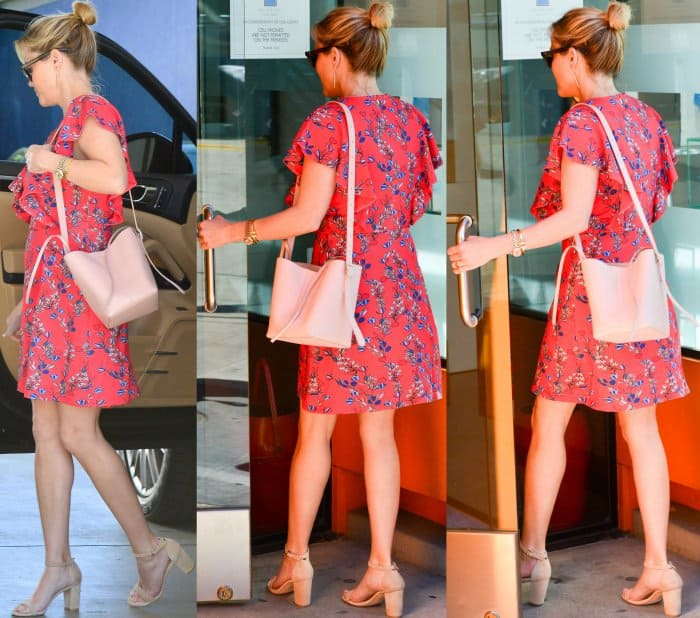 Reese Witherspoon wearing the Dunaway Vines Ruffle Knit Dress from Draper James and nude ankle-strap sandals