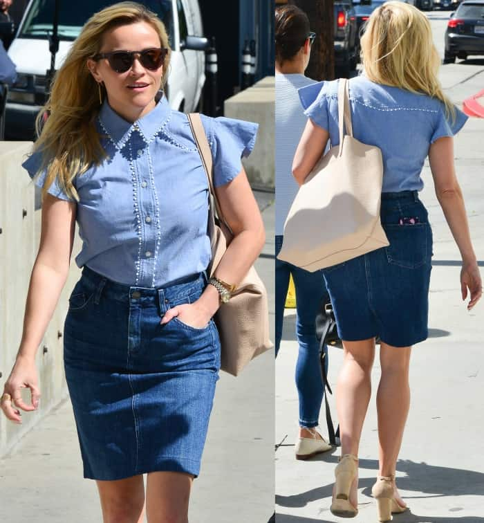 Reese Witherspoon wearing the Ruffle Chambray Button Down from Draper James, a denim skirt, and nude ankle-strap sandals